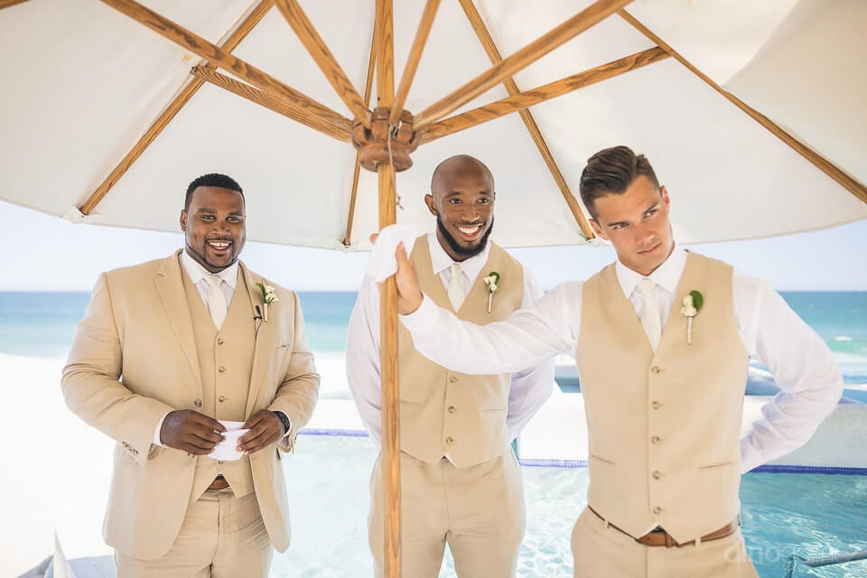 Handsome groom along with two other men is waiting eagerly for the bride to reach the stage- Amber & Josh