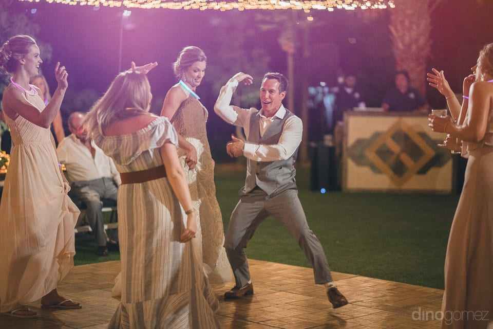 The groom is dancing with full energy and matching his dance steps with one of the lady at the dance floor- Heather & Ross