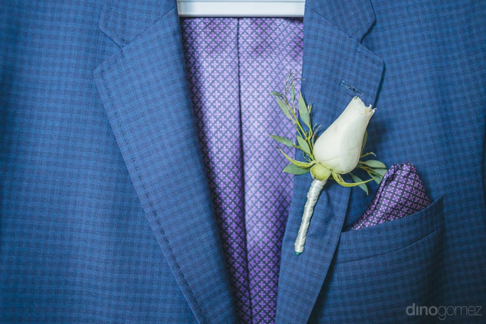 The image captures the checkered blue wedding suit of the groom- Jay & Drew