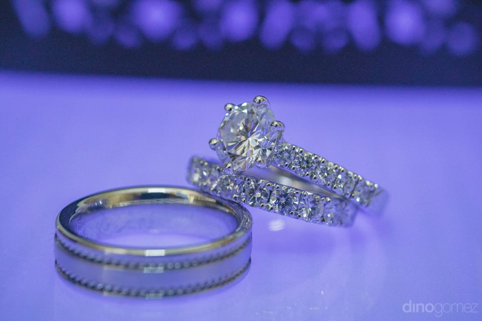 Big diamond wedding rings of the couple are captured beautifully- Jay & Drew