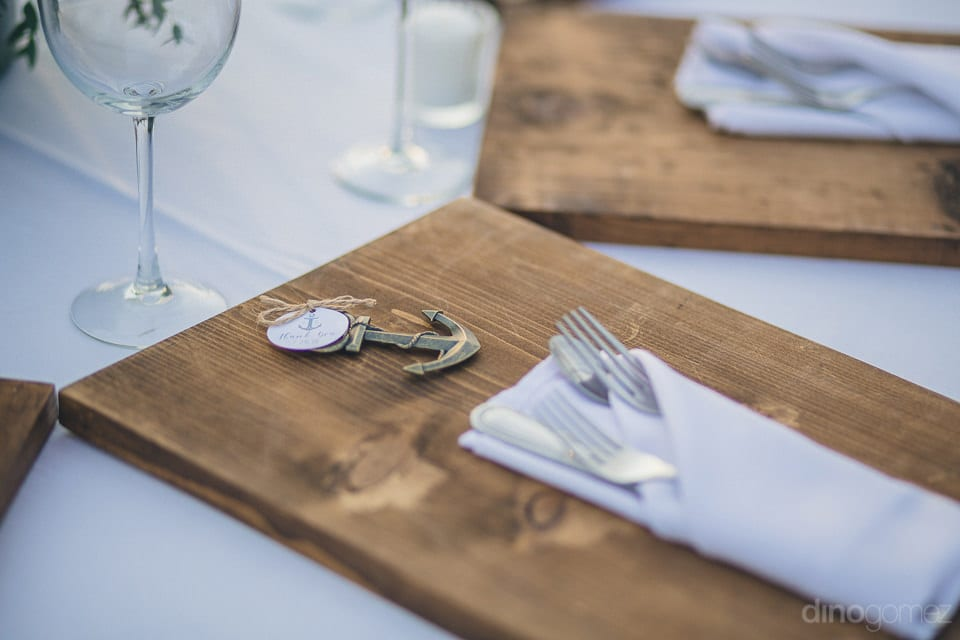 The dinning table of the newly married couple is decorated beautifully with the wooden plates and luxurious cutlery- Christina & Steve