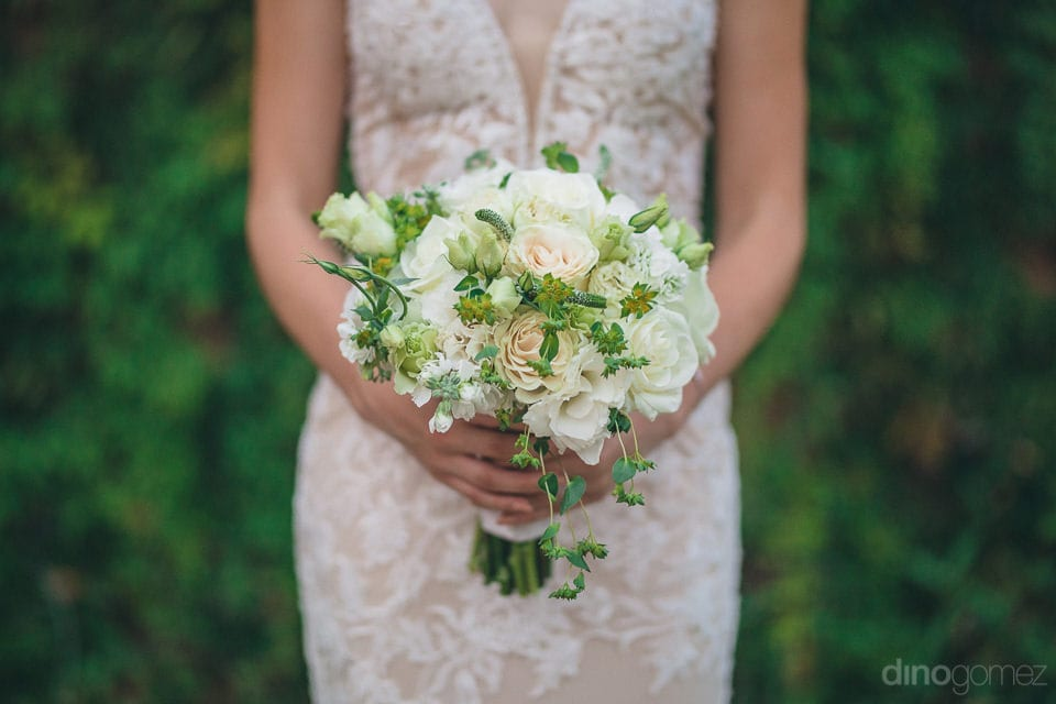 Picture Captures The Lovely Bouquet Of The Bride Being Held By Her On The Wedding Day- Christina & Steve