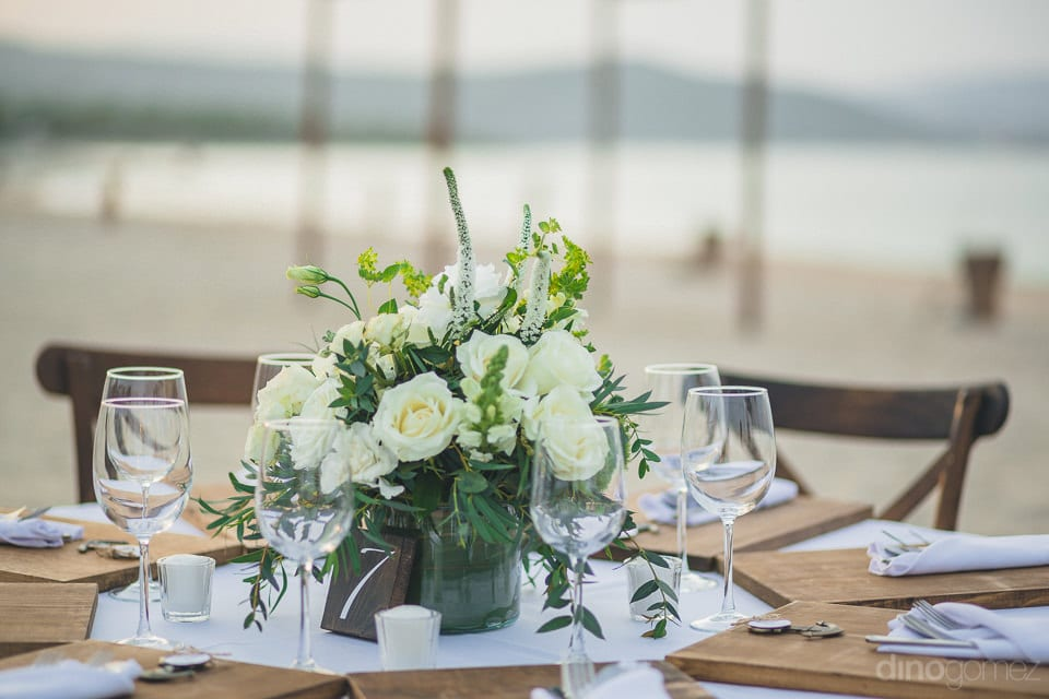 The Dinning Table Of The Lovely Couple Is Captured In The Image Decorated Beautifully With Wooden Plates And Fine Cutlery- Christina & Steve