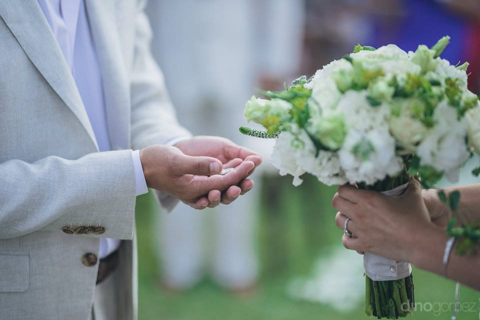 A Gentleman Is Holding Coins In His Hands And Is About To Accept The Bouquet From A Lady- Christina & Steve