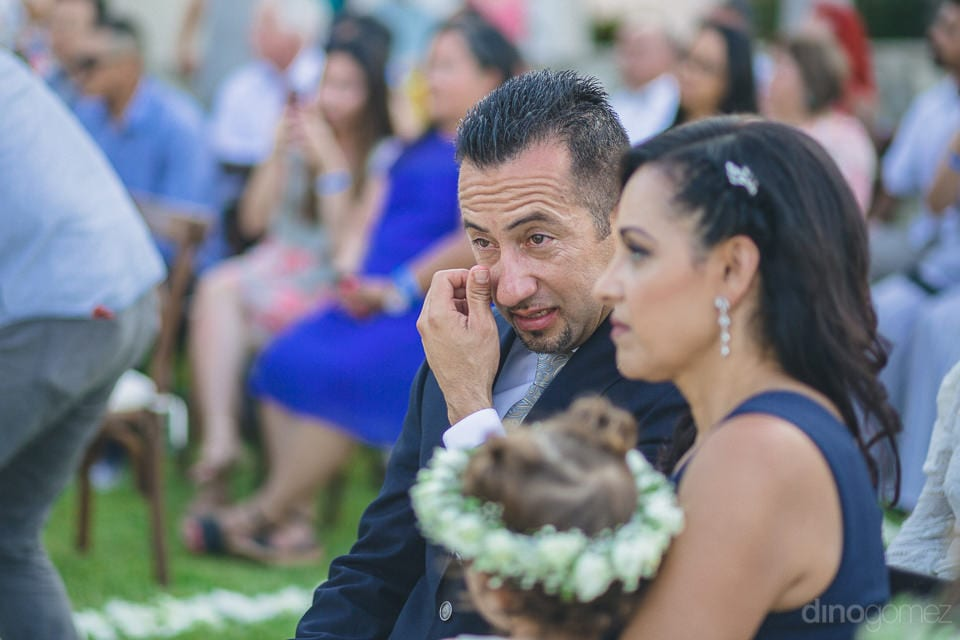 Picture focusses on the couple attending the wedding ceremony of the lovely couple- Christina & Steve