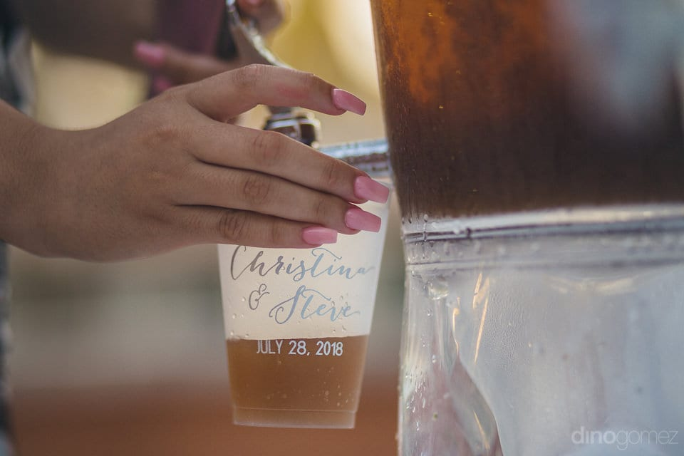 Picture focuses on the glass with the names and wedding date of the lovely couple printed on it- Christina & Steve