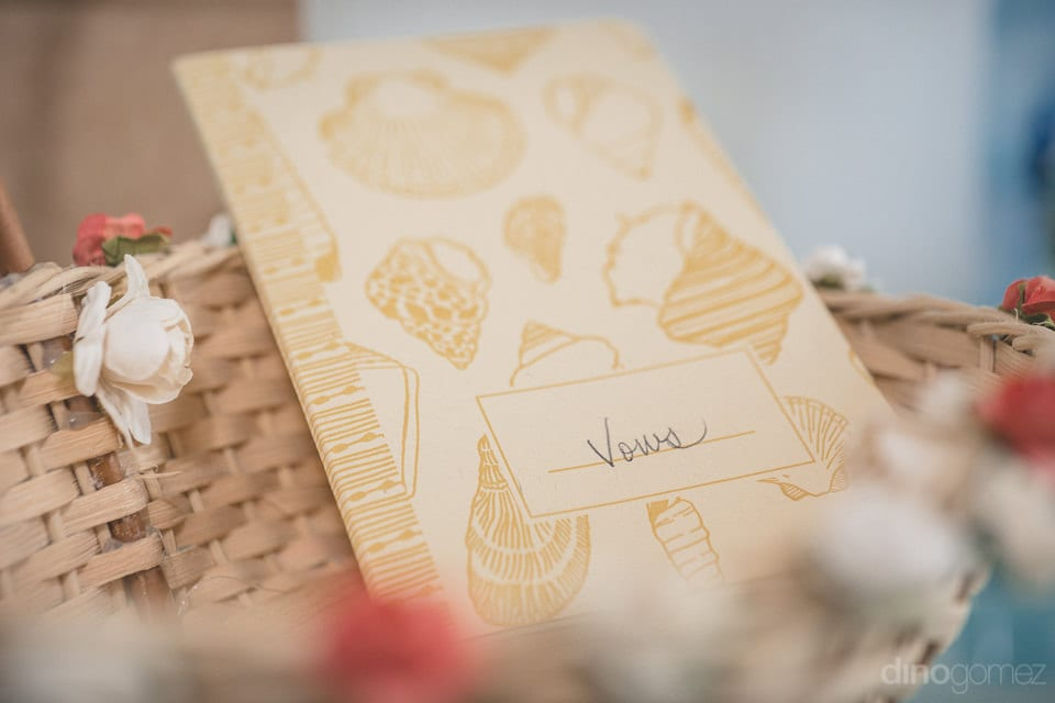 A brown colored diary with vows written on it is captured in the picture- Christina & Steve