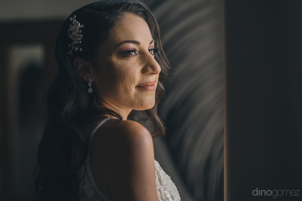 Picture captures the beautiful face of the bride all ready with the makeup for the wedding- Christina & Steve