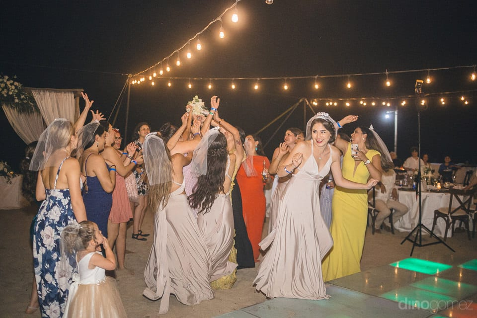 Picture captures the dancing moment of the wedding guests dancing on the music beats at the reception party- Christina & Steve