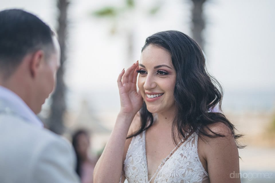 Gorgeous bride is smiling beautifully while looking at the groom during the wedding ceremonies- Christina & Steve