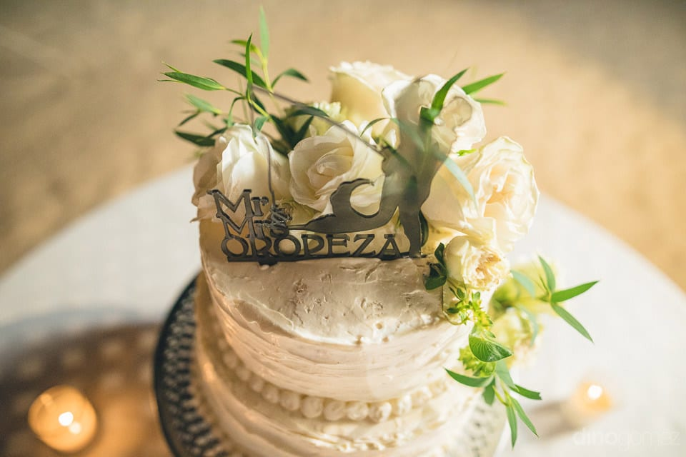 A Delicious White Cream Two Teir Cake Is Decorated With White Flowers For The Wedding Of The Lovely Couple- Christina & Steve