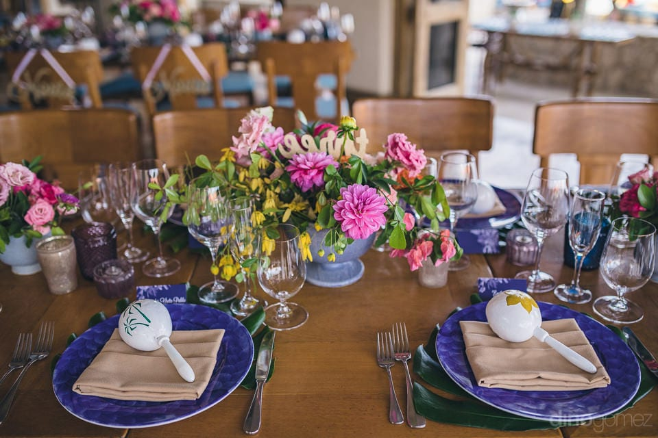 Beautiful dinning table of the lovely couple on the wedding day is decorated with colorful cutlery and flowers- Nicole & Ryan