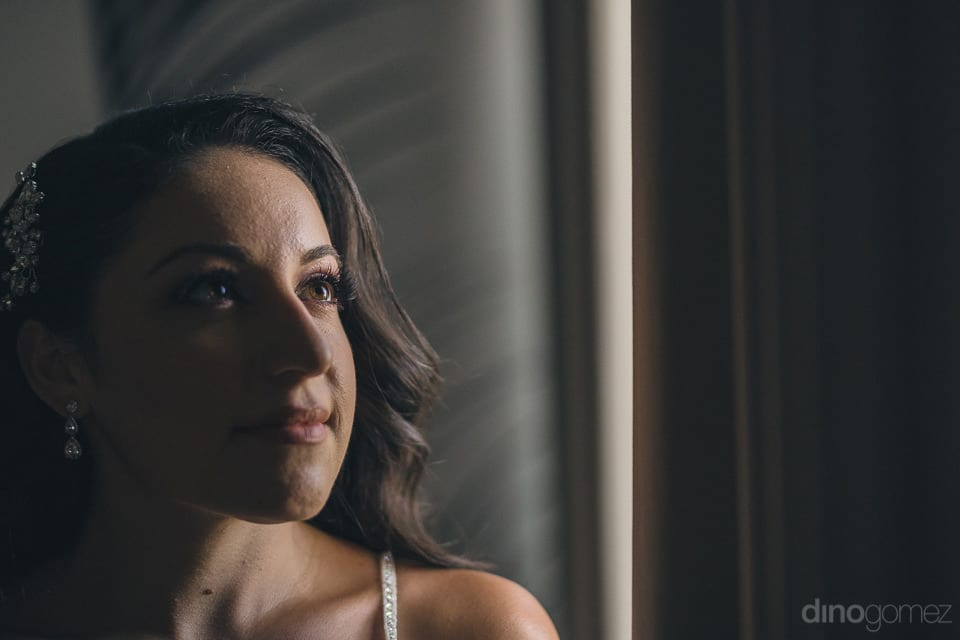 A Candid Shot Of The Gorgeous Bride Inside A Dark Room Is Captured- Christina & Steve