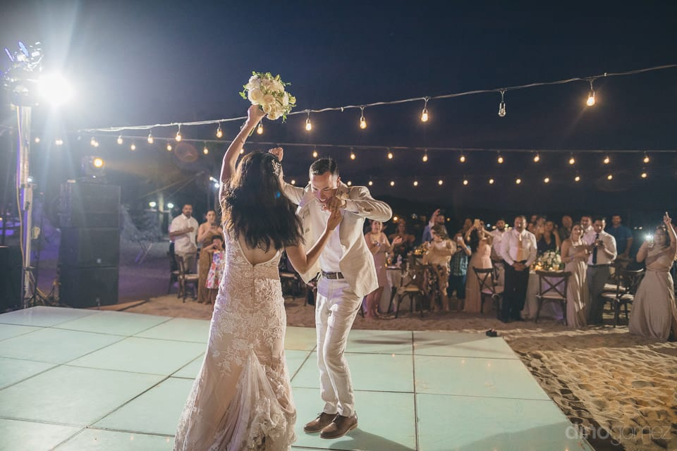 The bride and groom are dancing to the fullest on the dance floor at the evening reception party- Christina & Steve