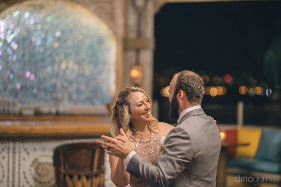A lovely lady is smiling broadly while dancing with the handsome groom in the evening dance party- Nicole & Ryan