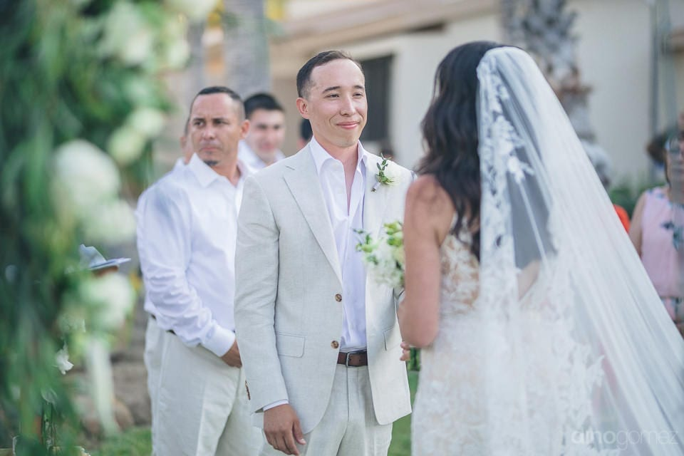 Groom Can Be Seen Wearing A Braod Smile On His Face While Looking At The Bride During The Wedding Ceremonies- Christina & Steve