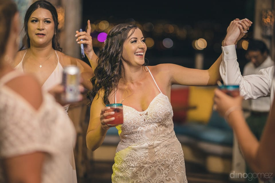 The bride is dancing to the fullest at the evening reception party with the guests- Nicole & Ryan