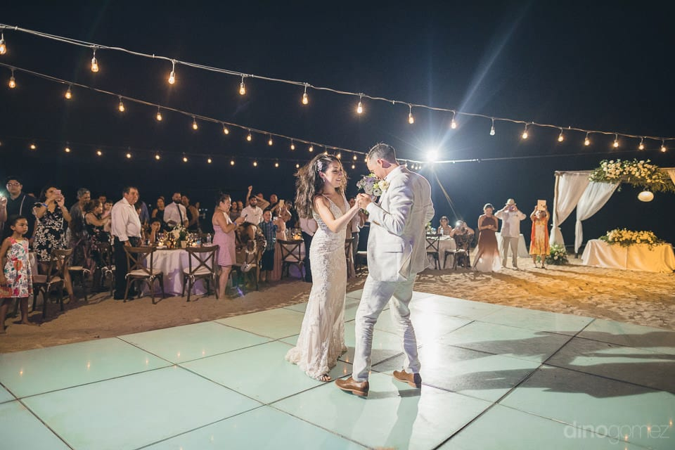 Newly married couple is dancing with full energy at the reception party on the beachside- Christina & Steve