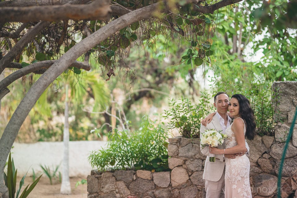 The couple is standing in beautiful garden and is posing wonderfully for the camera- Christina & Steve