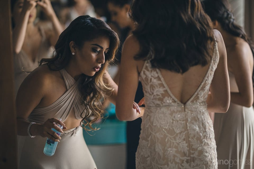 One Of The Bridemaids Is Applying A Spray On The Arms Of The Gorgeous Bride Before The Wedding Ceremonies- Christina & Steve