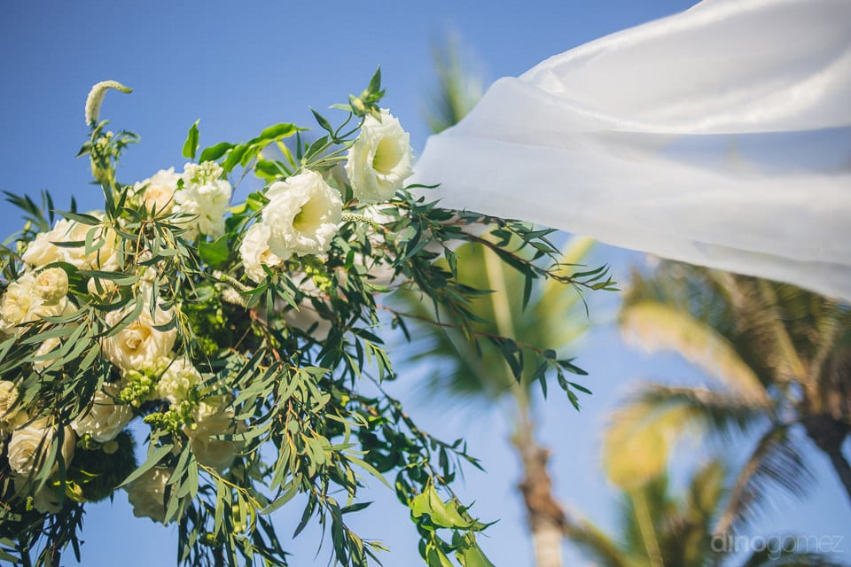 Picture Captures The Beautiful White Roses Hanging On The Wooden Pole At The Wedding Venue Of The Couple- Christina & Steve