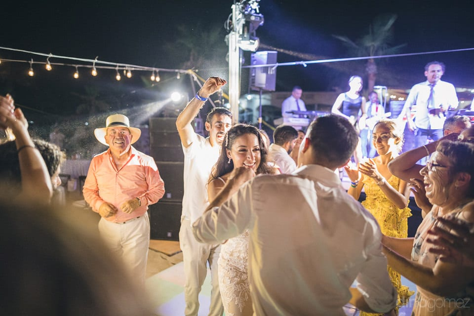 Picture captures the newly married couple dancing under bright yellow lights at the reception party- Christina & Steve