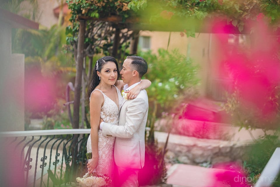 Gorgeous couple is hugging each other and the bride is looking at the camera to give a stunning pose- Christina & Steve