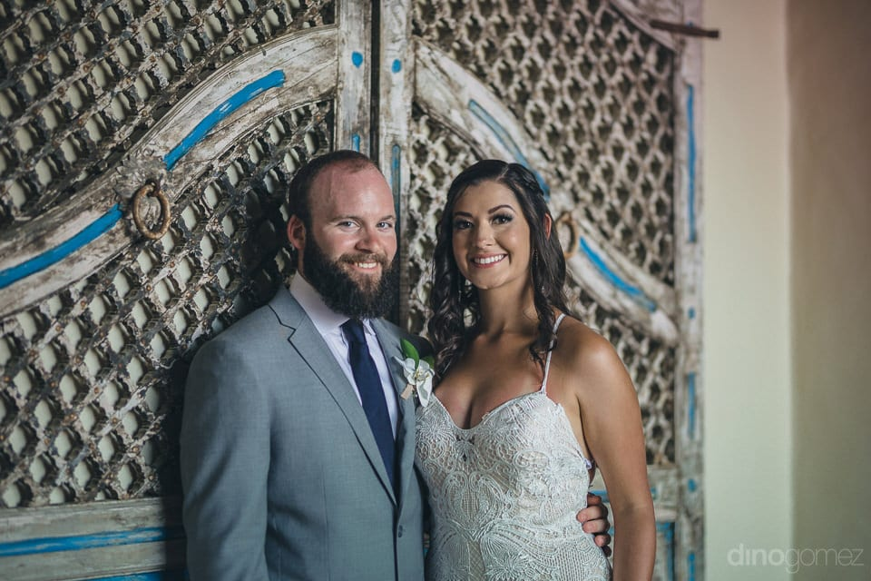 Lovely couple is posing infront of a beautifully carved antique door for the camera- Nicole & Ryan