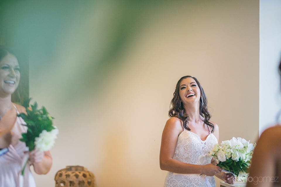 Lovely bride is laughing loudly while holding her wedding bouquet in her hands- Nicole & Ryan