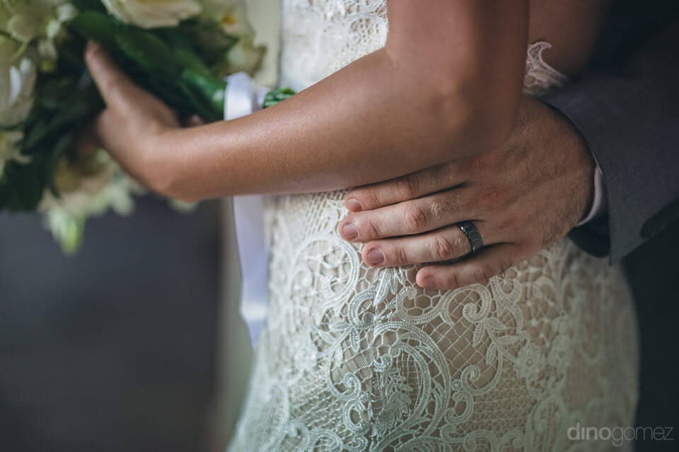 Picture captures the hands of the groom placed on the waist of the lovely bride- Nicole & Ryan