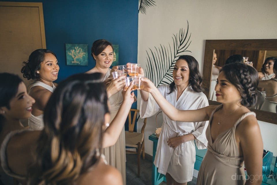 Gorgeous Bride And Her Bridemaids Are Raising A Toast Together Inside The Hotel Room Before The Wedding Of Lovely Couple- Christina & Steve