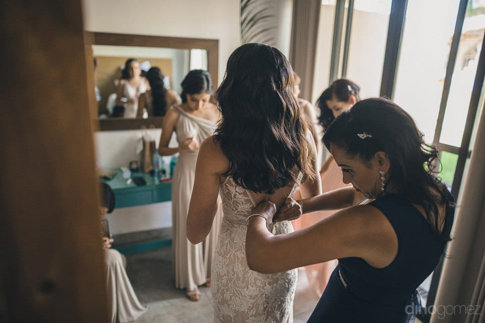 The bride can be seen getting her wedding gown's zip done with the help of one of the bridemaids for her Big day- Christina & Steve