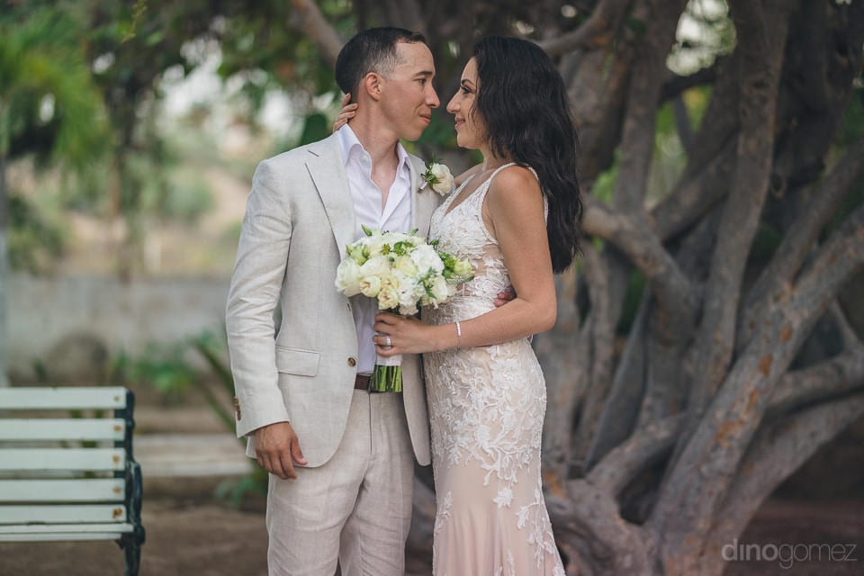 Gorgeous couple is smiling while looking deep into each others eyes to pose for the camera- Christina & Steve