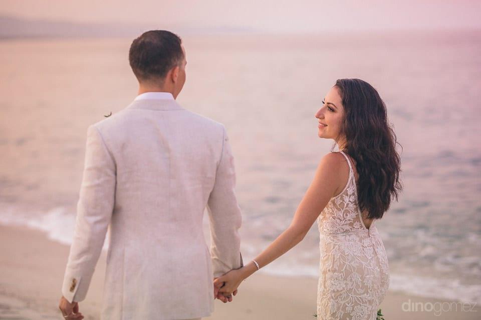 Side view of the couple during their romantic beachside walk is captured in the picture- Christina & Steve