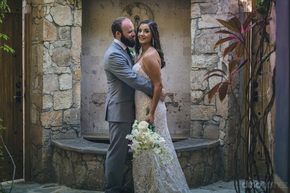 Lovely couple is hugging each other while posing infront of a beautiful wall made up of big stones- Nicole & Ryan