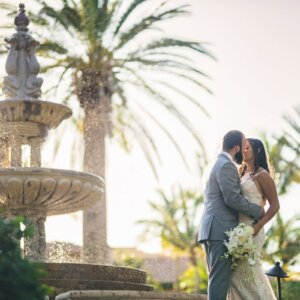 Lovely couple is looking fantastic standing at a picturesque location and kissing each other- Nicole & Ryan
