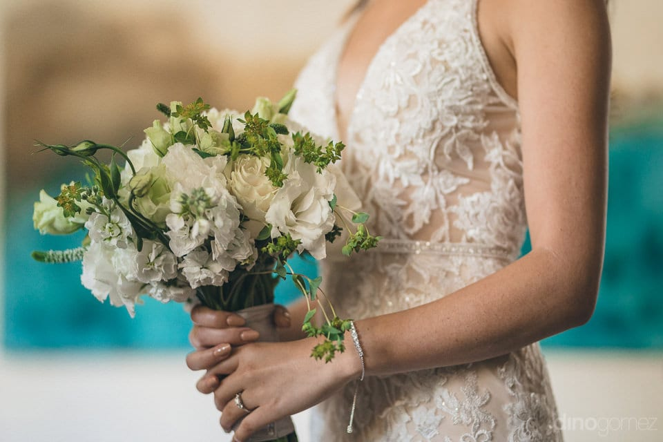 A beautiful wedding bouquet of the bride made out of white flowers is captured in the picture- Christina & Steve