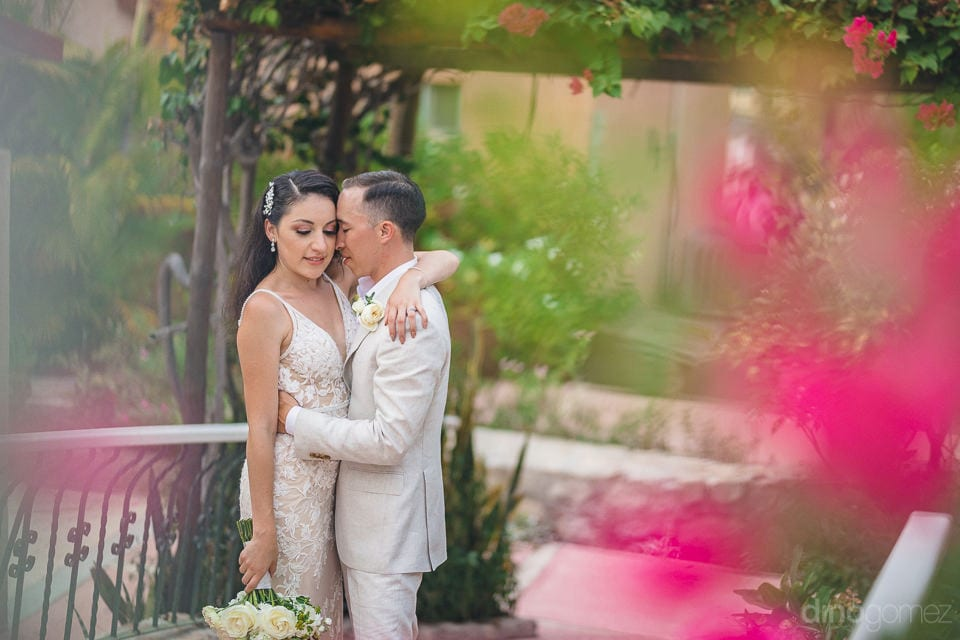 Newly Married Couple Is Lovingly Hugging Each Other Standing In The Middle Of Lovely Garden- Christina & Steve