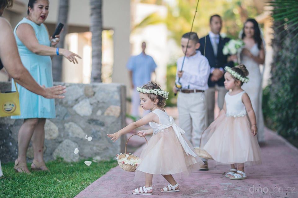 Lovely little baby girls are dressed beautifully in gowns and are spreading white rose petals on the aisle of the bride- Christina & Steve