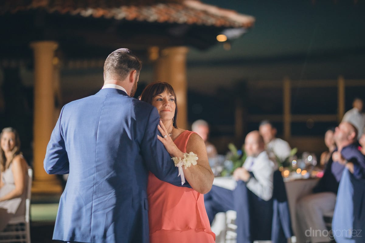 A Lovely Lady Dressed In Peach Colored Dress Is Dancing With A Gentleman At The Evening Party Of The Couple- Kathleen & Kevin