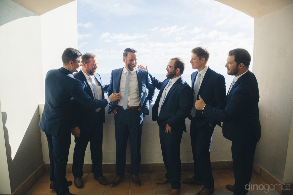 Handsome groom and all his friends are dressed in lovely blue colored suits and are posing amazingly for the camera- Kathleen & Kevin