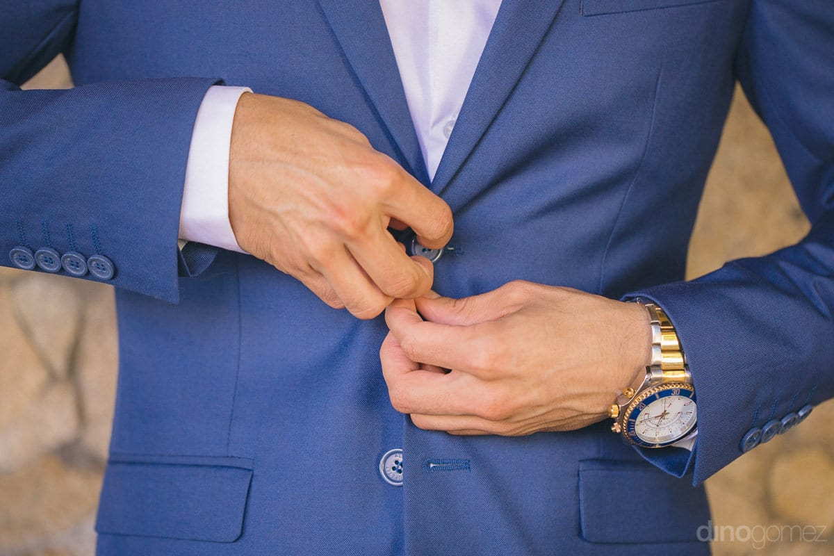 A perfect shot of a gentleman wearing blue suit and getting ready for the wedding party is captured by the los cabo photographer- Nikki and David