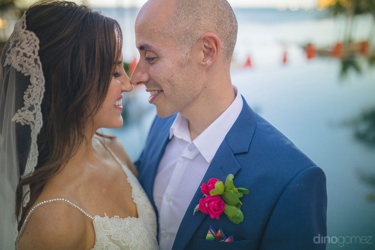 The Headline! - USE KEYPretty newly married couple is standing close while facing each other at the beachside to pose romantically for the camera- Nikki and DavidWORDS