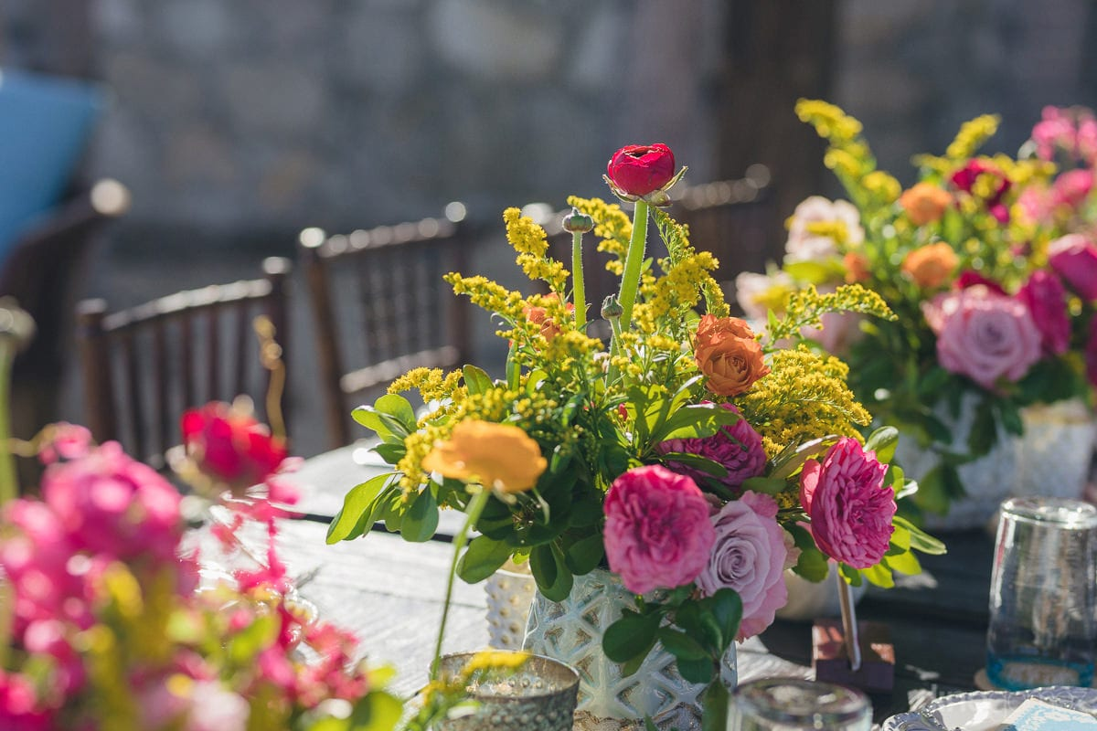 A beautiful colorful shot of the lovely roses placed in a vase on the dinning table of the newly married couple- Nikki and David