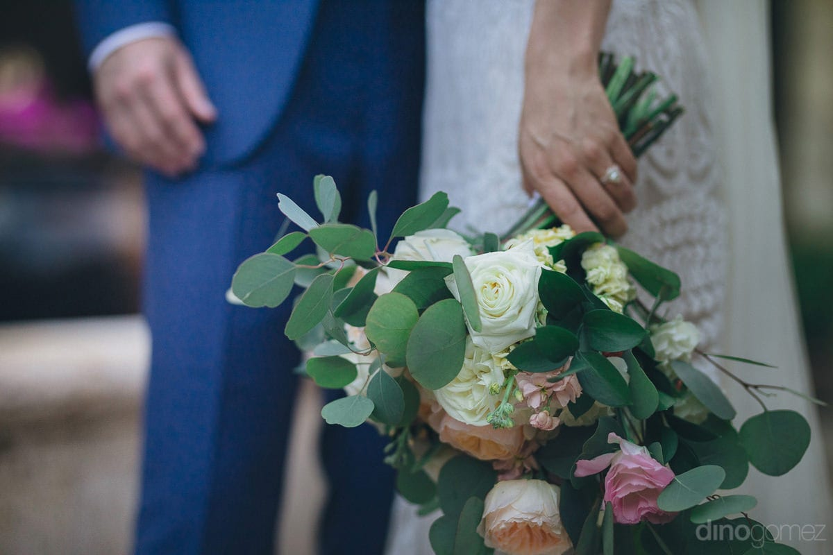 The bride's alluring wedding bouquet is beautifully captured in the picture- Kathleen & Kevin