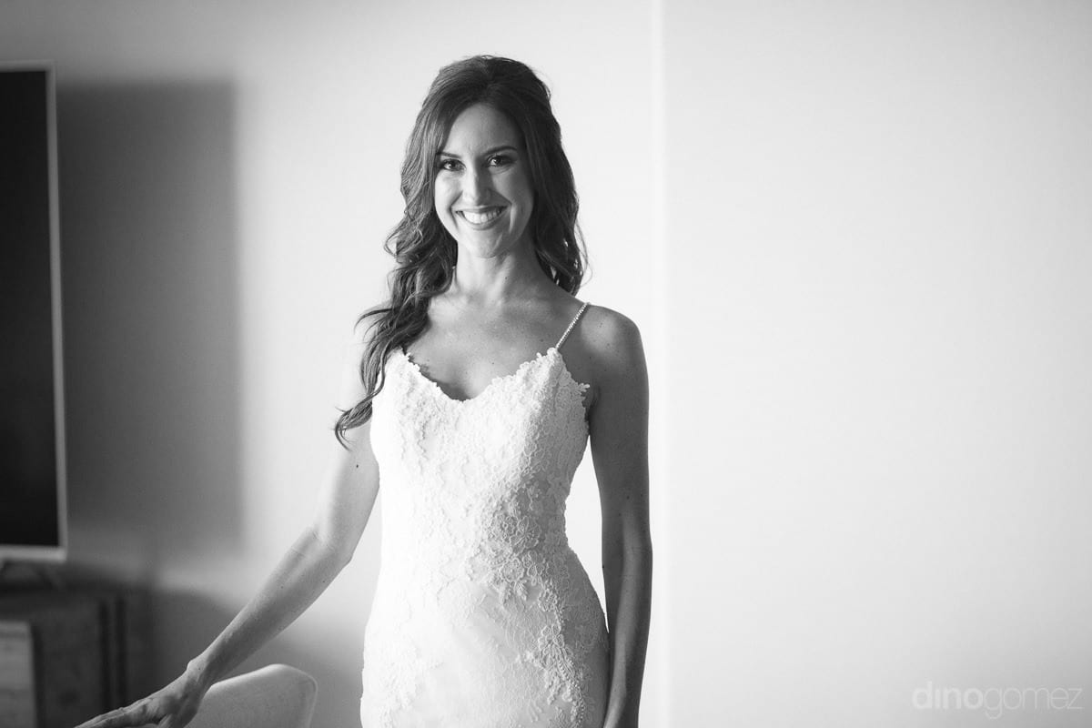 A black and white potrait shot of the gorgeous bride dressed in white wedding gown is captured- Nikki and David