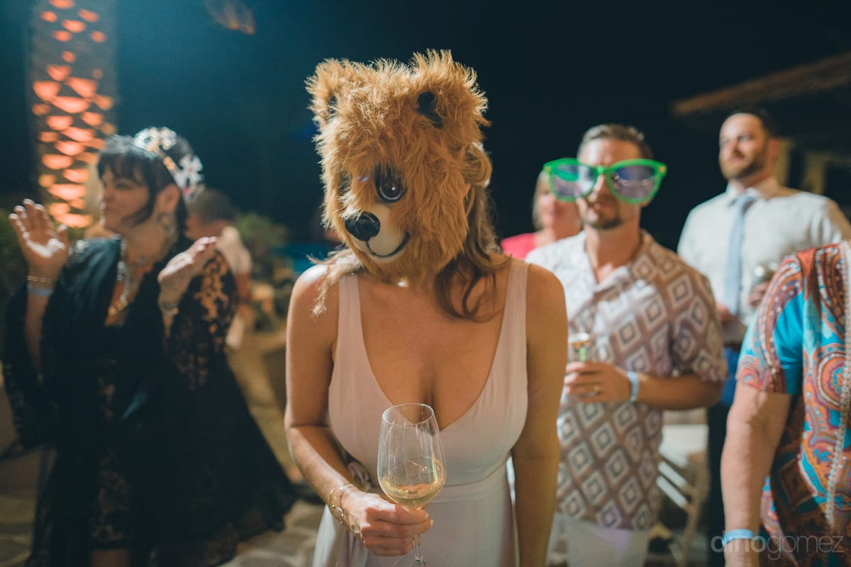A Young Lady Wearing A Cute Animal Face Mask Is Enjoying Her Drinks And Dance Along With Other Wedding Guests At The Reception Party- Kathleen & Kevin