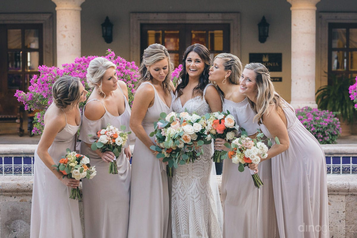 The bridemaids can be seen giving a striking pose with the bride for the camera- Kathleen & Kevin