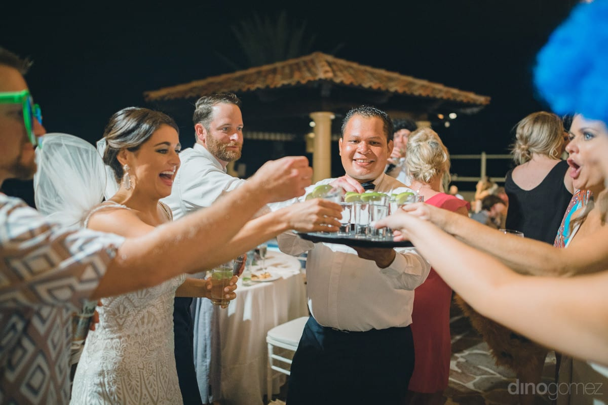Lovely bride can be seen enjoying drinks and dance with her friends at the reception party along the beachside- Kathleen & Kevin