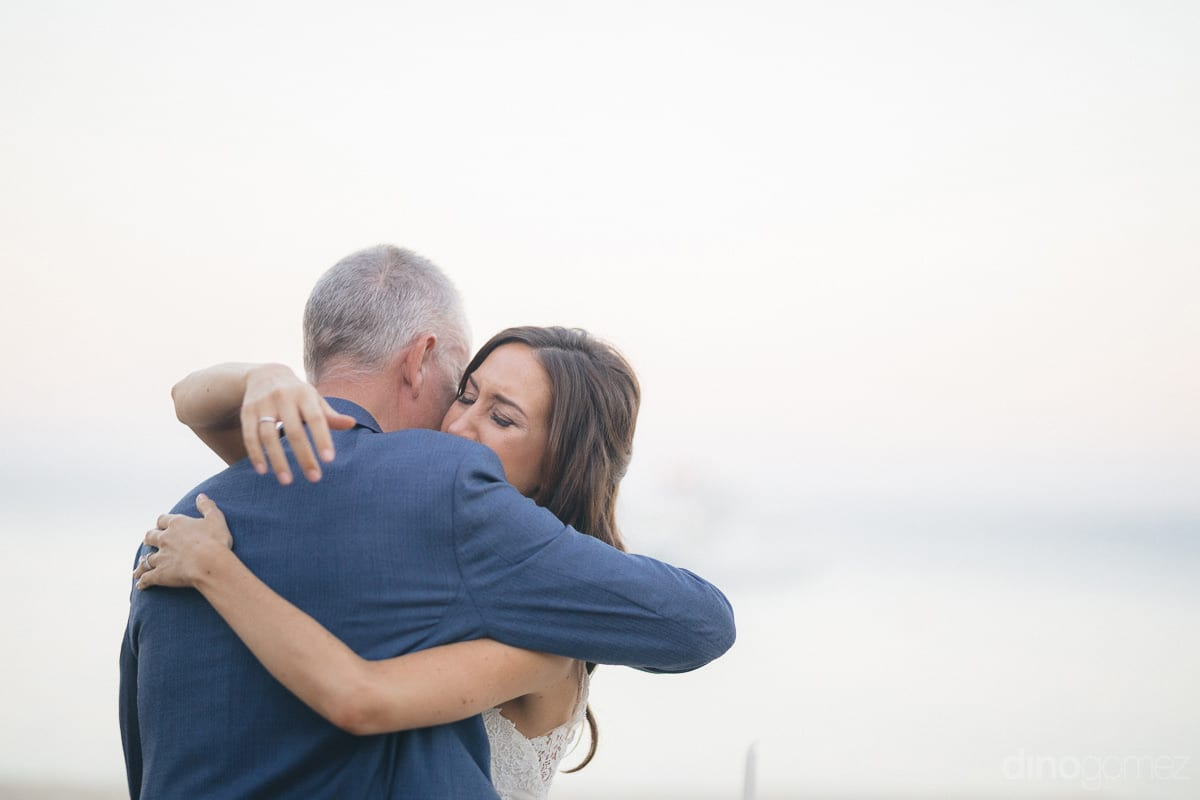 Lovely bride is emotionally hugging a gentleman on her wedding day- Nikki and David